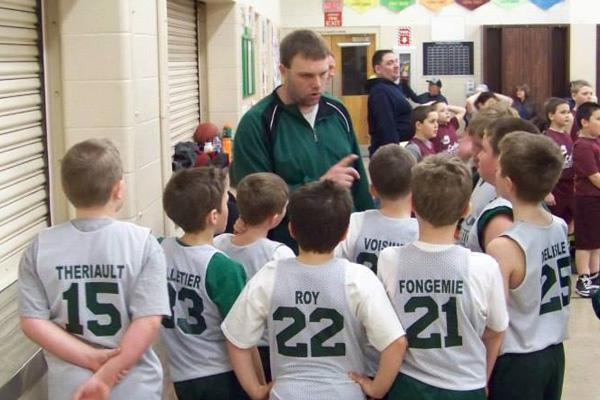 Travis Delisle, pictured here Coaching Fort Kent's 3/4th Grade Boy's AYBL team this past spring, will be the next UMFK Head Women's Basketball Coach